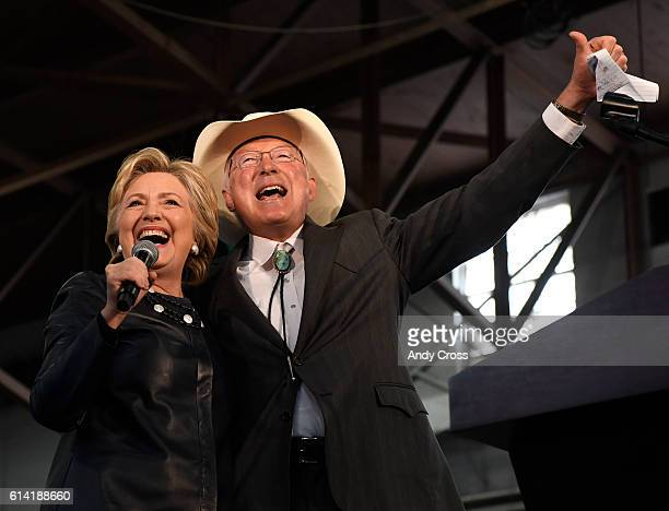 Hillary Clinton gets a hug from former Secretary of the Interior Ken Salazar at the beginning of the Colorado Democratic Party Rally at the Palace of...