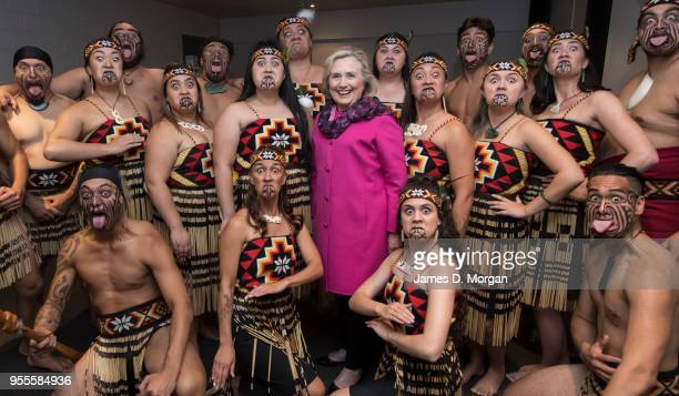Hillary Clinton poses for a group photo with a Maori performing arts group called 'Te Kapa Haka o Whangara Mai Tawhiti' who opened 'An Evening with...