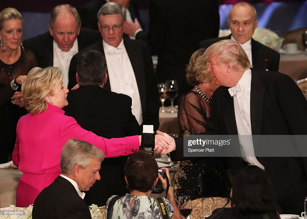 Hillary Clinton shakes hands with Donald Trump while attending the annual Alfred E. Smith Memorial Foundation Dinner at the Waldorf Astoria on October 20, 2016 in New York City.The white-tie dinner, which benefits Catholic charities and celebrates former Governor of New York Al Smith, has been attended by presidential candidates since 1960 and gives the candidates an opportunity to poke fun at themselves and each other.