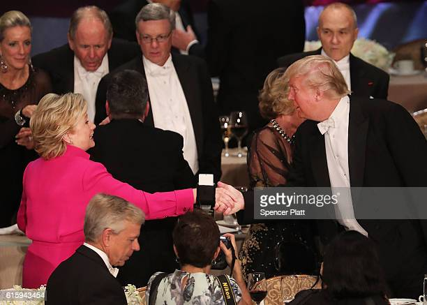 Hillary Clinton shakes hands with Donald Trump while attending the annual Alfred E Smith Memorial Foundation Dinner at the Waldorf Astoria on October...