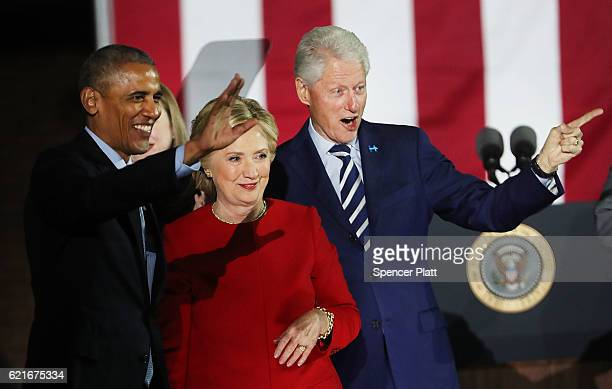 Hillary Clinton stands with President Barack Obama and former President Bill Clinton during an election eve rally on November 7 2016 in Philadelphia...