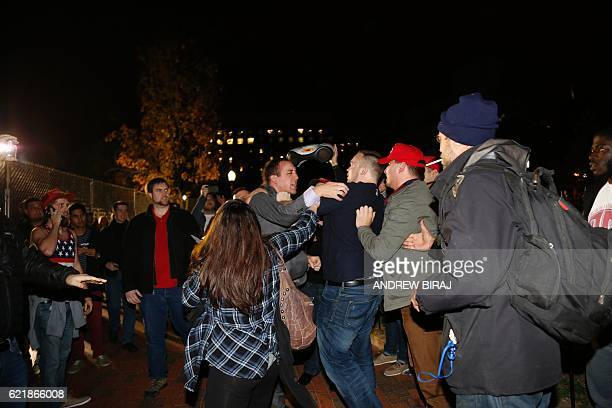 Hillary Clinton supporter clashes with a Donald Trump supporter outside the White House early November 9 2016 in Washington DC Trump stunned America...