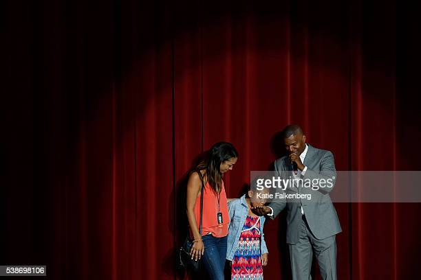 Hillary Clinton supporter Jamie Foxx makes his seven year old daughter Annalise Bishop center spit out her gum as other daughter Corrine Bishop...