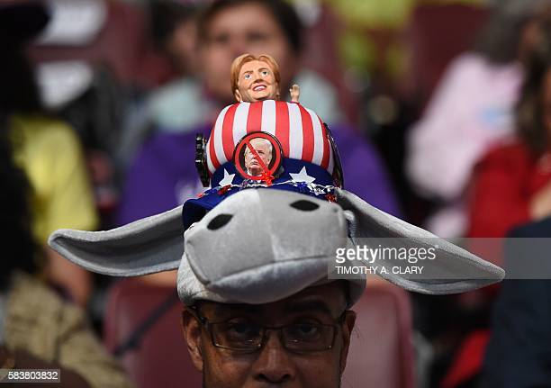 A Hillary Clinton supporter wears a donkey hat with a Hillary doll on Day 3 of the Democratic National Convention at the Wells Fargo Center July 27...
