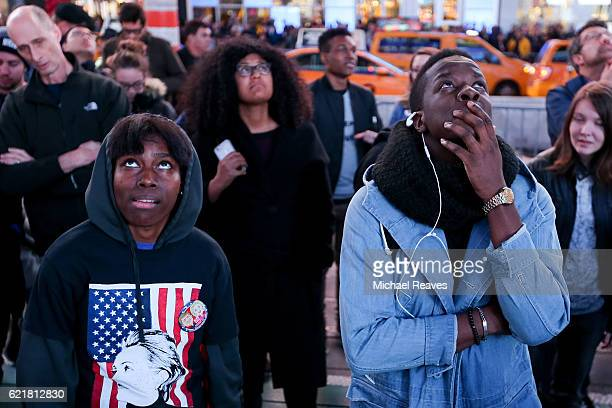 Hillary Clinton supporters react after Donald Trump was projected to win the state of Florida in Times Square on November 8 2016 in New York City...