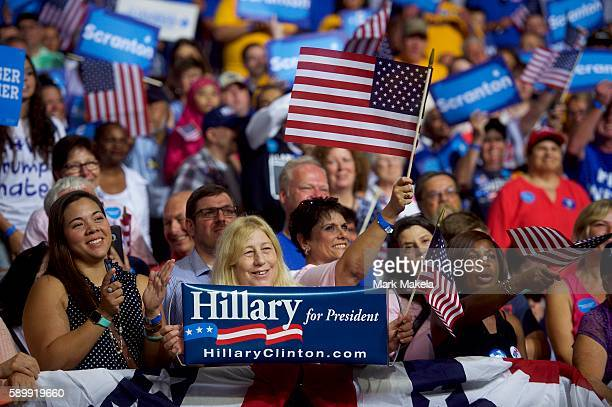 Hillary Clinton supporters react to her speech during a rally with Vice President Joe Biden at Riverfront Sports athletic facility on August 15 2016...
