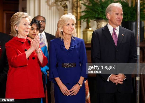 Hillary Clinton US secretary of state left Joseph Biden US vice president right and his wife Jill Biden wait for US President Barack Obama and First...