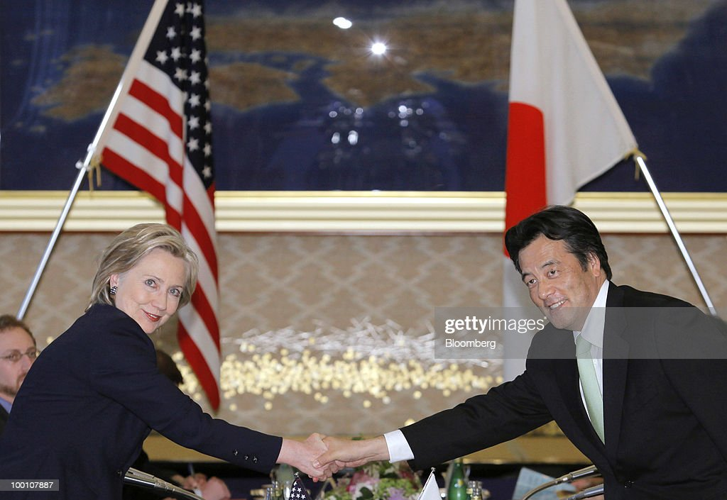 Hillary Clinton, U.S. secretary of state, left, shakes hands with Katsuya Okada, Japan's foreign minister, before their meeting at the Iikura Guest House in Tokyo, Japan, on Friday, May 21, 2010. Clinton arrived in Asia today for talks with China and U.S. allies now focused on how to manage a crisis over suspected North Korean involvement in the sinking of a South Korean warship. Photographer: Itsuo Inouye/Pool via Bloomberg