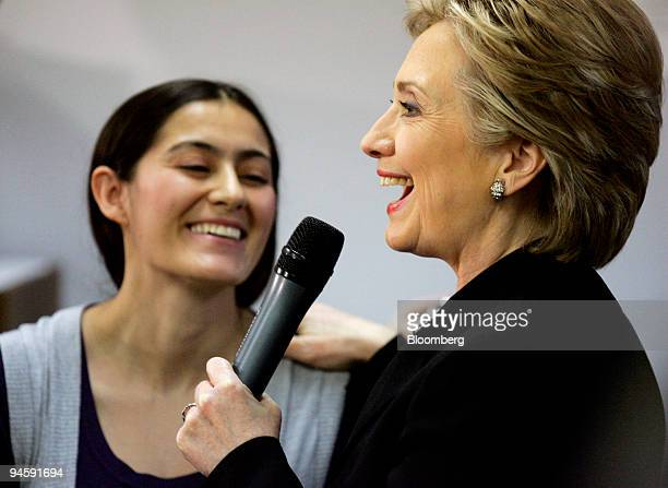 Hillary Clinton US senator from New York and Democratic presidential candidate right shares a laugh with Sandra Agudelo of Henderson Nevada during a...