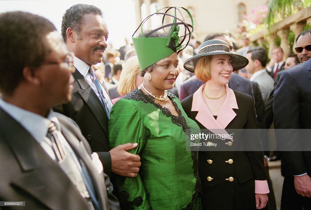 Hillary Clinton, Winnie Mandela, and Jesse Jackson at Inauguration : News Photo