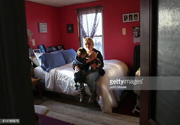 Hillary Comparone holds her children Cameron Comparone 2 1/2 years and Lincoln 4 1/2 months in her bedroom on March 6 2016 in Plainville Connecticut...