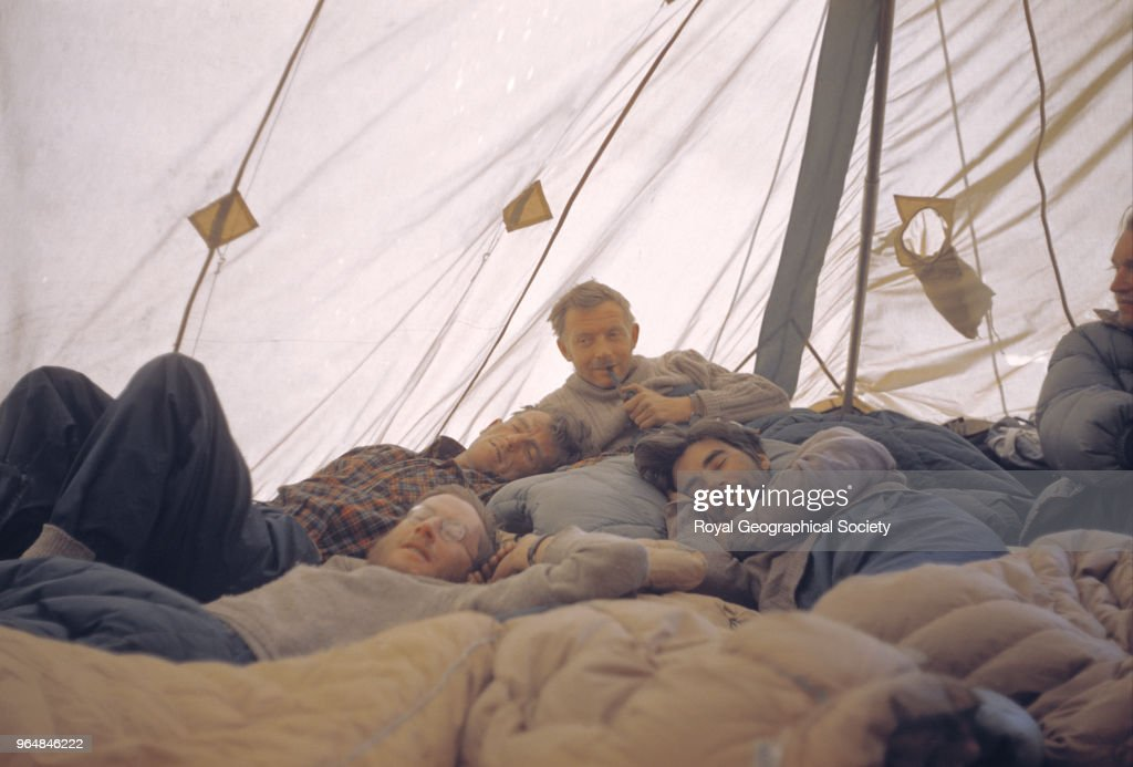 Hillary, Evans, Ward and Band lying in a tent listening to the Coronation, Nepal, 2nd June 1953. Mount Everest Expedition 1953.
