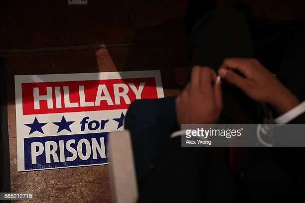 """Hillary for Prison"""" sign is seen during a campaign event for Republican presidential nominee Donald Trump at Briar Woods High School August 2, 2016..."""