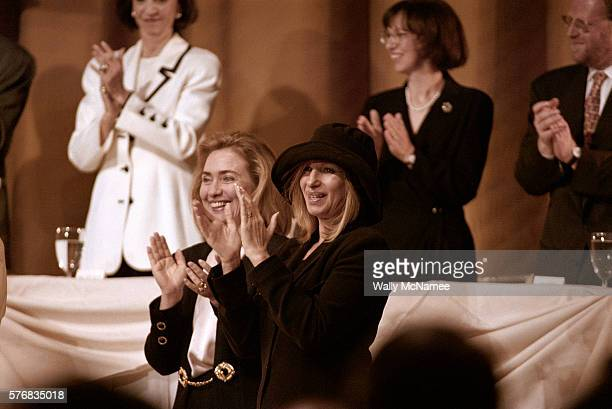 Hillary Rodham Clinton and Barbra Streisand clap at a Jewish Federation luncheon in Los Angeles