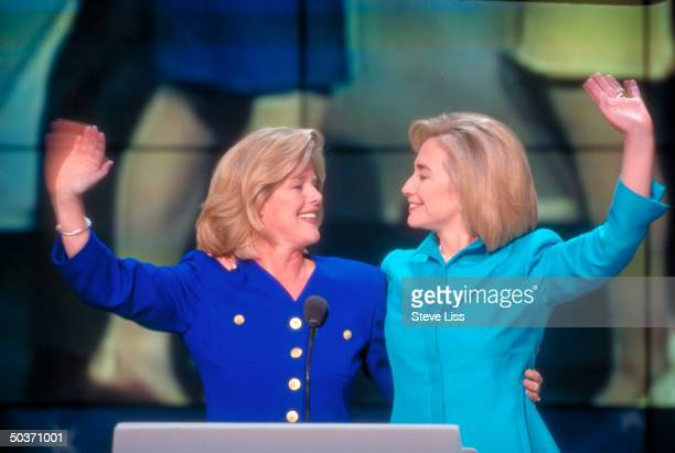 Hillary Rodham Clinton and Tipper Gore exchange warm smiles while waving to supporters at the 1996 Democratic National Convention