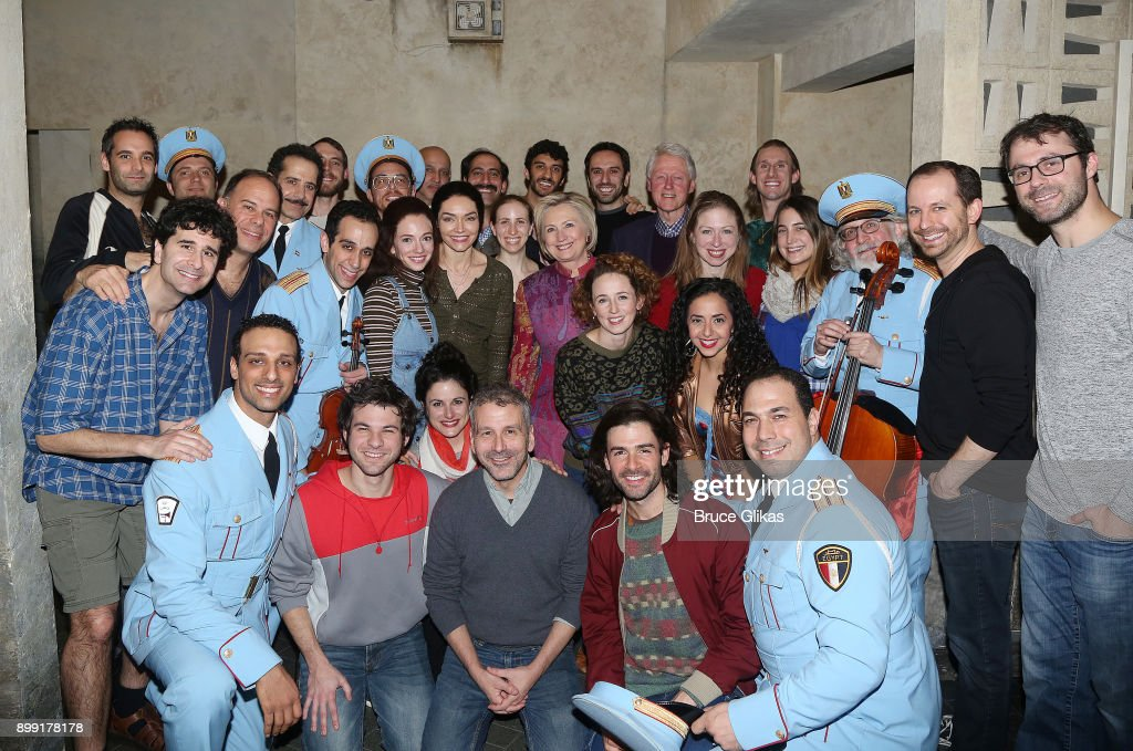 Hillary Rodham Clinton, Bill Clinton, Chelsea Clinton Mezvinsky and Marc Mezvinsky pose with the cast backstage at the hit musical 'The Band's Visit' on Broadway at The Barrymore Theatre on December 27, 2017 in New York City.