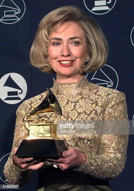Hillary Rodham Clinton holds up her Grammy Award 26 February at Madison Square Garden in New York The First Lady received the award for best spoken...