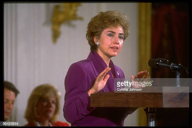 Hillary Rodham Clinton speaking from podium regarding her constantly changing hairstyles