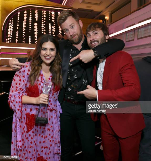 Hillary Scott Charles Kelley and Dave Haywood of Lady Antebellum take photos during the 2018 CMT Artists of The Year at Schermerhorn Symphony Center...