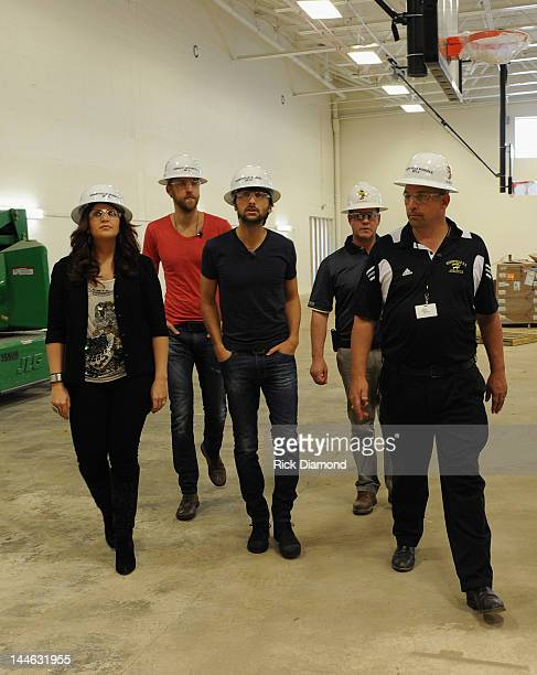 Hillary Scott Charles Kelley and Dave Haywood of Lady Antebellum with Principal Troy Albert visit Henryville High School on May 16 2012 in Henryville...