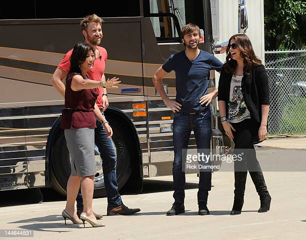 Hillary Scott Charles Kelley and Dave Haywood of Lady Antebellum with ABC News Correspondent Juju Chang during a visit of Henryville High School on...