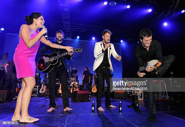 Hillary Scott Charles Kelley and Dave Haywood of the band Lady Antebellum make recording artist Luke Bryan take his boots off as he joins them at the...