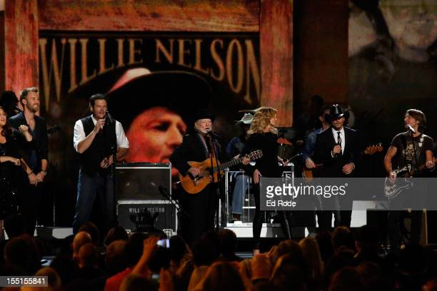 Hillary Scott Charles Kelley Blake Shelton Willie Nelson Faith Hill Tim McGraw and Keith Urban perform during the 46th annual CMA awards at the...