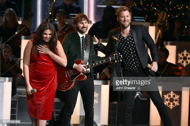 Hillary Scott Dave Haywood and Charles Kelley of Lady Antebellum perform onstage for CMA 2017 Country Christmas at The Grand Ole Opry on November 14...