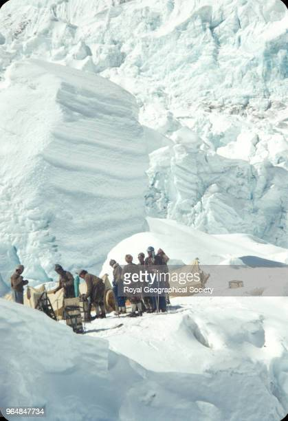 Hillary with Sherpas at camp in the icefall Nepal March 1953 Mount Everest Expedition 1953