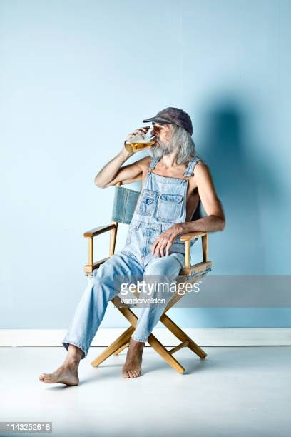 hillbilly drinking alcohol - director's chair stock pictures, royalty-free photos & images
