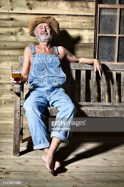 hillbilly relaxing with a beer - hillbilly stock pictures, royalty-free photos & images