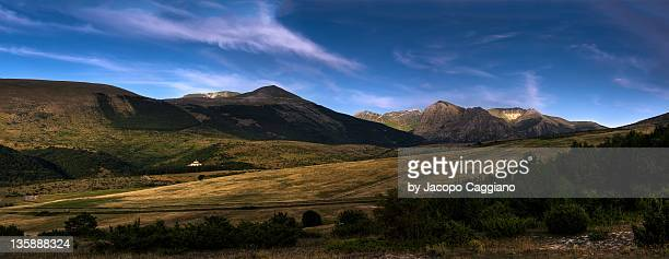 hills and blue sky - jacopo caggiano stock pictures, royalty-free photos & images
