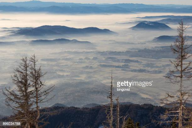 hills and fields covered in fog - kranj stock pictures, royalty-free photos & images