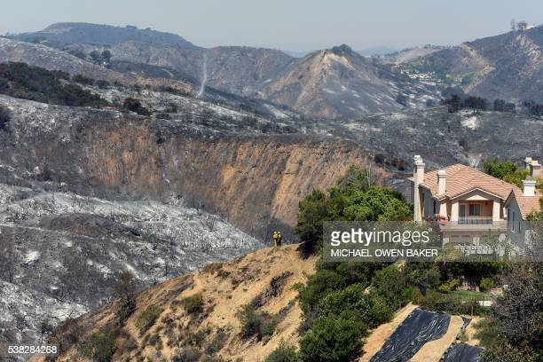 Hills burnt from a wildfire surrounding a home on Ganelon Drive June 5 2016 in Calabasas California Some 5000 people were evacuated from the...
