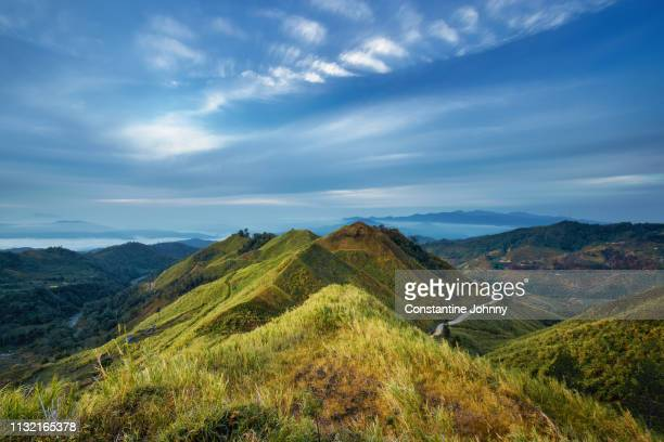 hills landscape view at early morning. sosodikon hill, kundasang, sabah - sabah state stock pictures, royalty-free photos & images