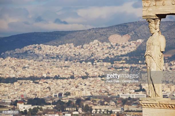 hills of athens seen behind erechtheion caryatid - international landmark stock pictures, royalty-free photos & images