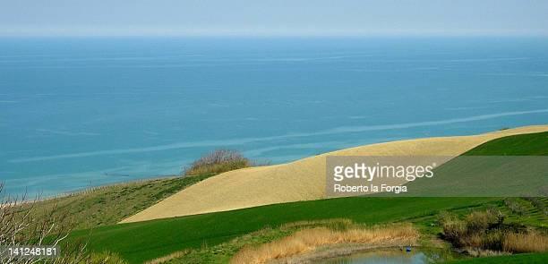 hills on sea - hügelkette stock-fotos und bilder