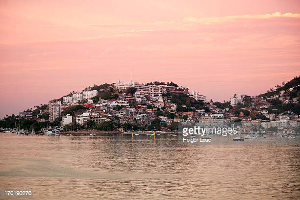 hillside houses at sunrise - acapulco stock pictures, royalty-free photos & images