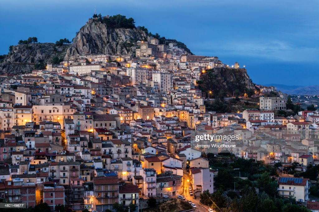 Hillside town at dusk, Nicosia, Sicily, Italy : Stock Photo
