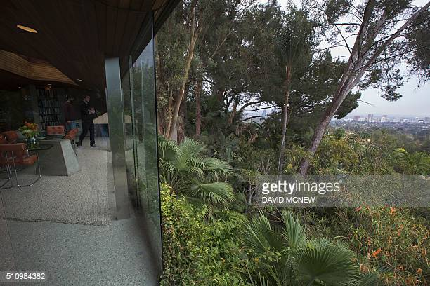 Hillside tropical foliage surrounds the John Lautnerdesigned home being donated to the Los Angeles County Museum of Art by fashion and basketball...