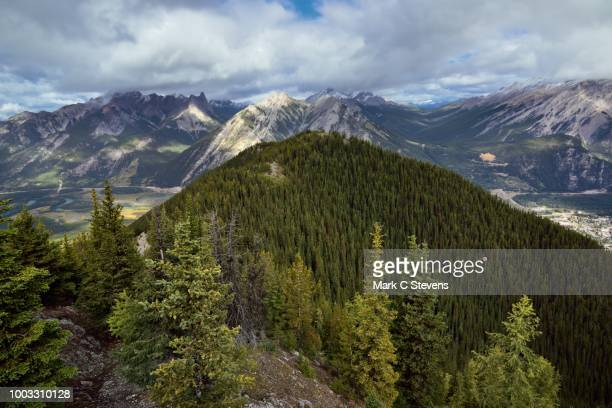 hillsides, a valley and mountain peaks. - sulphur mountain stock pictures, royalty-free photos & images
