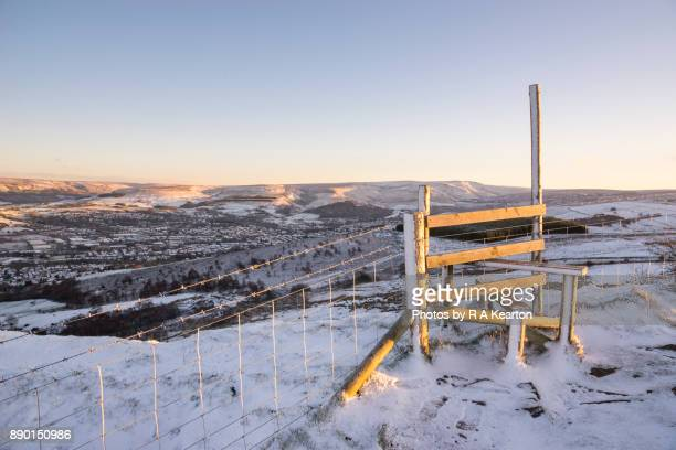 Hilltop stile on a snowy winter morning