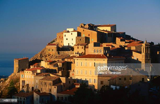 hilltop village houses in evening. - david cliff stock pictures, royalty-free photos & images