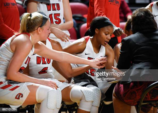 Hilltoppers forward Tashia Brown points out to Western Kentucky Lady Toppers head coach Michelle ClarkHeard a play during a time during the first...