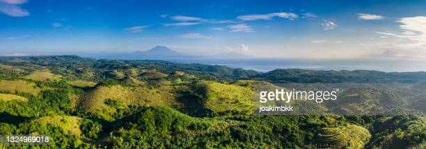 hilltops of nusa penida in bali indonesia - nusa penida stock pictures, royalty-free photos & images