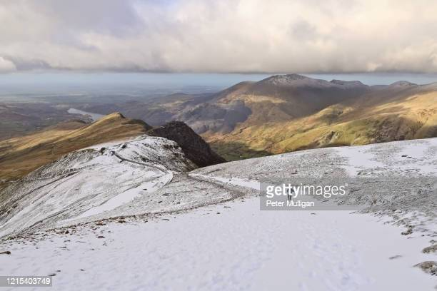hillwalker descending snowdon via the llanberis path - weather stock pictures, royalty-free photos & images