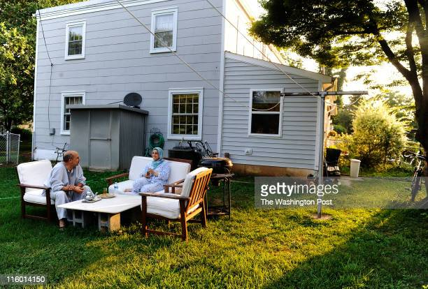 Hillwood Square residents Houda Bensaida and his wife Thamy Oubenali enjoy their evening ritual drinking tea in their yard on June 08 2011 in Falls...