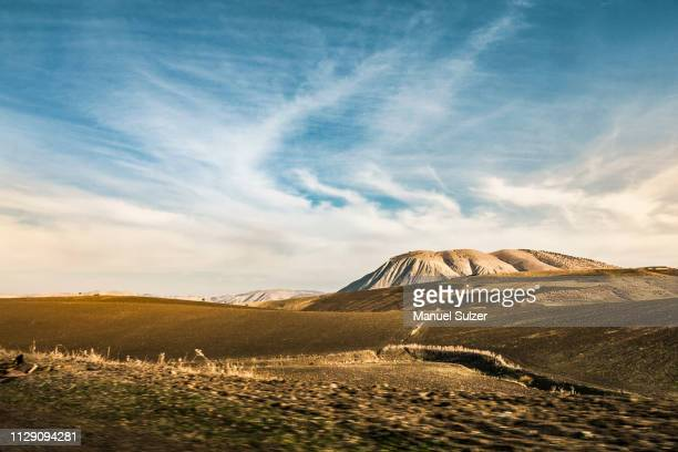 hilly arid landscape with distant mountains, chefchaouen, morocco - chefchaouen photos et images de collection