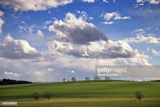 hilly landscape on a stormy day - bernd schunack stockfoto's en -beelden