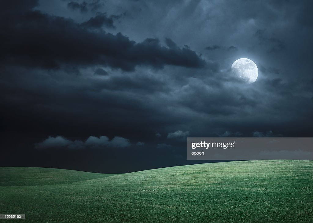Hilly meadow at night with full moon, clouds and grass : Stock Photo